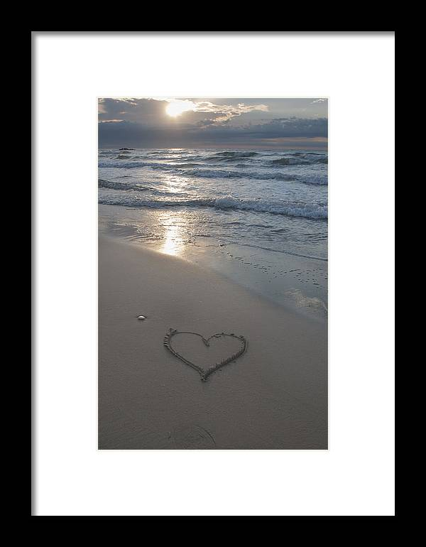 Sunset Framed Print featuring the photograph Heart At The Beach by Oscar Hurtado