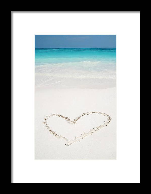 Affectionate Framed Print featuring the pyrography Hearts Drawn In Beach by Auttapon Moonsawad