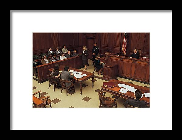 Crowd Framed Print featuring the photograph High angle view of courtroom by Comstock