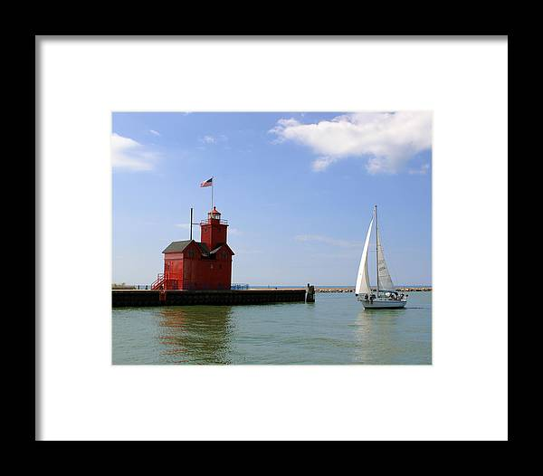 Light Framed Print featuring the photograph Holland Harbor Lighthouse With Sailboat by George Jones
