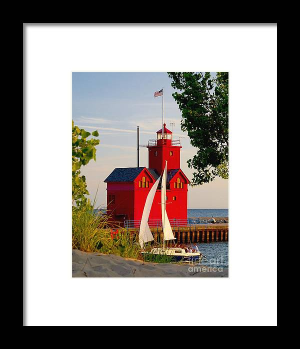 Attraction Framed Print featuring the photograph Holland Lighthouse by Nick Zelinsky