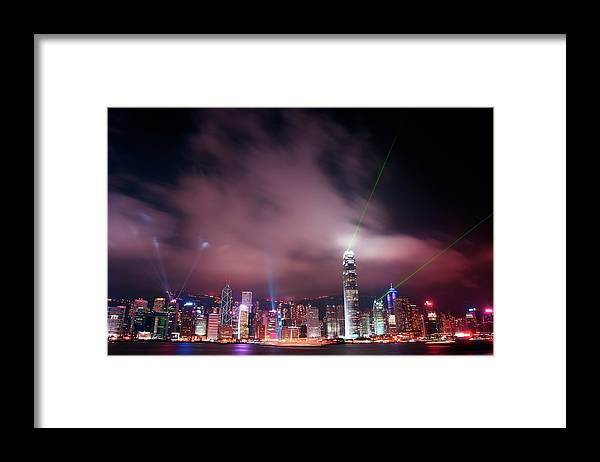 Tranquility Framed Print featuring the photograph Hong Kong Laser Lights by Photo By Dan Goldberger