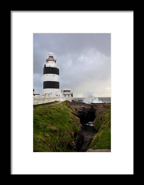 Landscape/ Lighthouse/ Waves Framed Print featuring the photograph Hook Head Lighthouse by Ann O Connell