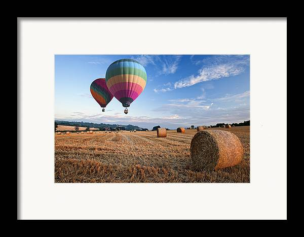 Landscape Framed Print featuring the photograph Hot Air Balloons Over Hay Bales Sunset Landscape by Matthew Gibson