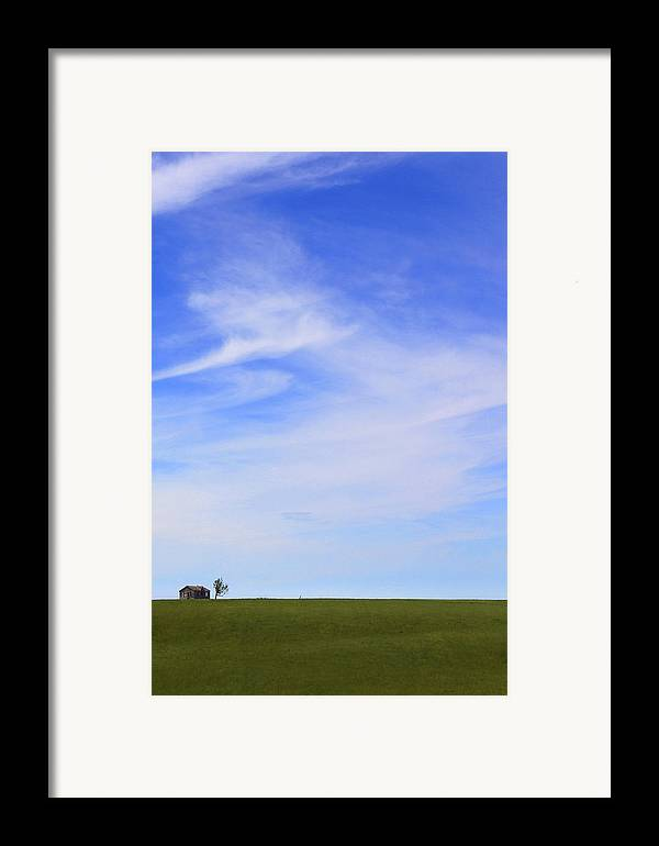 Interesting Clouds Framed Print featuring the photograph House On The Hill by Mike McGlothlen