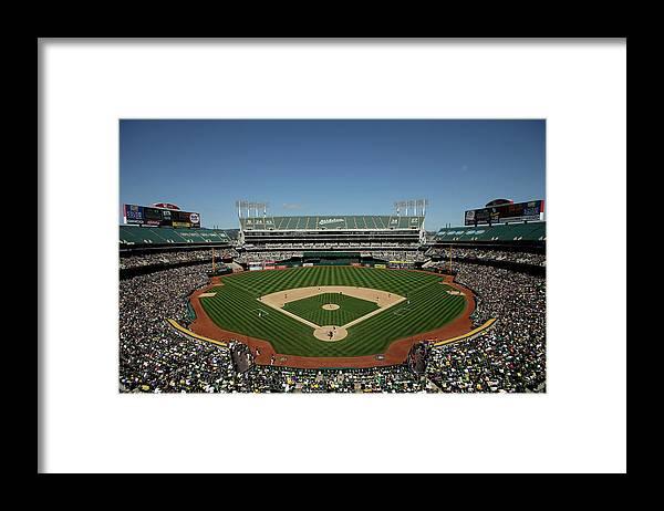 American League Baseball Framed Print featuring the photograph Houston Astros V Oakland Athletics by Ezra Shaw