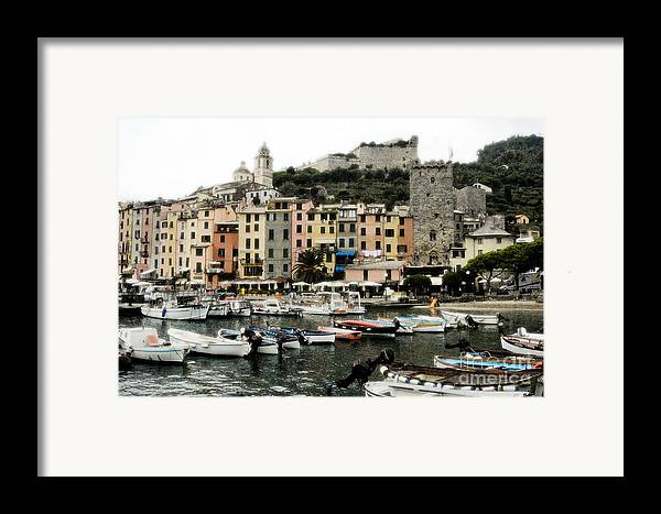 Monterosso Village In The Cinqueterre With Boats Docked In The Harbour Framed Print featuring the photograph Italian Seaside Village by Jim Calarese