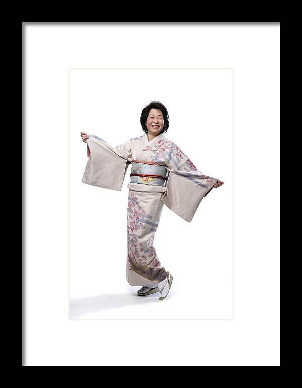 Japanese Mature Woman Looking At Camera Framed Print By Jun Takahashi