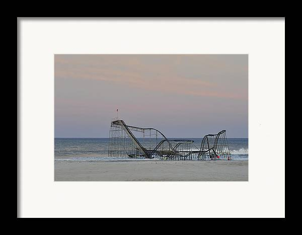 Jet Star Framed Print featuring the photograph Jet Star At Dusk by Terry DeLuco