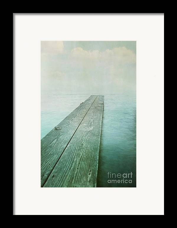 Photomanipulation Framed Print featuring the photograph Jetty by Priska Wettstein