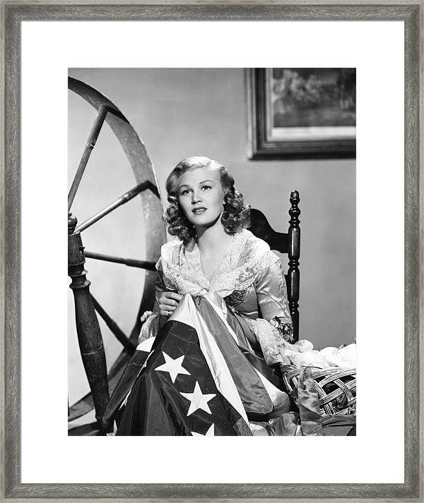 photograph relating to Betsy Ross Printable Pictures named Joan Caulfield As Betsy Ross, Sewing Framed Print