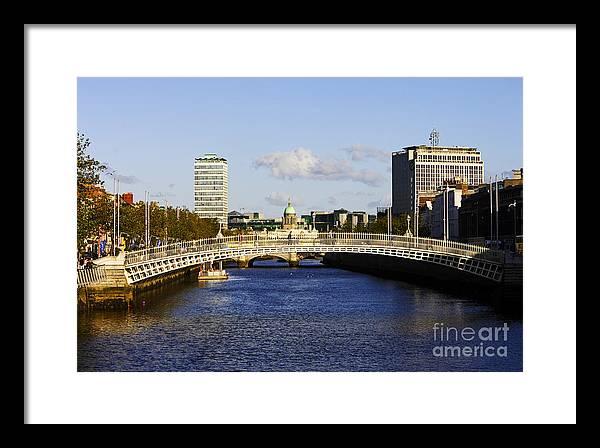 Hapenny Framed Print featuring the photograph Joe Fox Fine Art - Hapenny Liffey Bridge Over The River Liffey In Central Dublin Ireland by Joe Fox