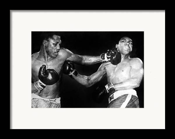Ali Framed Print featuring the photograph Joe Frazier Vs. Muhammad Ali by Everett
