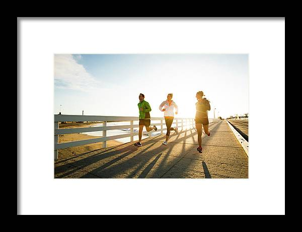Young Men Framed Print featuring the photograph Jogging Along The Coast by Jordan Siemens