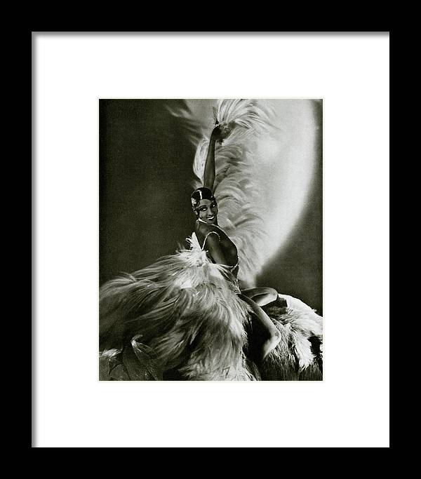 Dance Framed Print featuring the photograph Josephine Baker Wearing A Feathered Cape by George Hoyningen-Huene