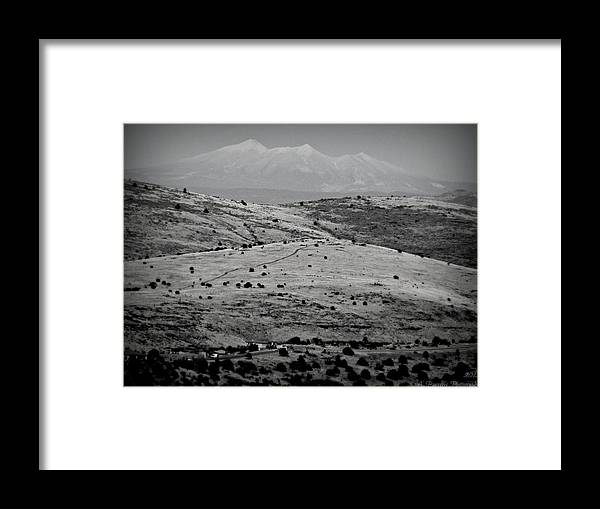 Prescott Framed Print featuring the photograph Juniper Hills To Snowy Arctic Peaks Black And White by Aaron Burrows