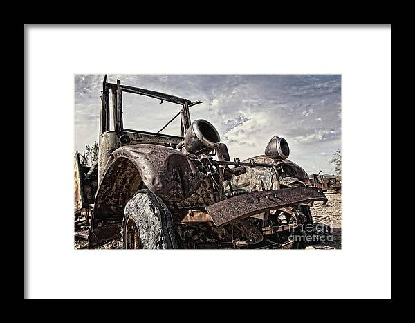 Old Truck Framed Print featuring the photograph Junk Yard Sentinel Stands by Lee Craig