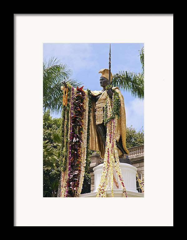 Aliiolani Framed Print featuring the photograph Kamehameha Covered In Leis by Brandon Tabiolo