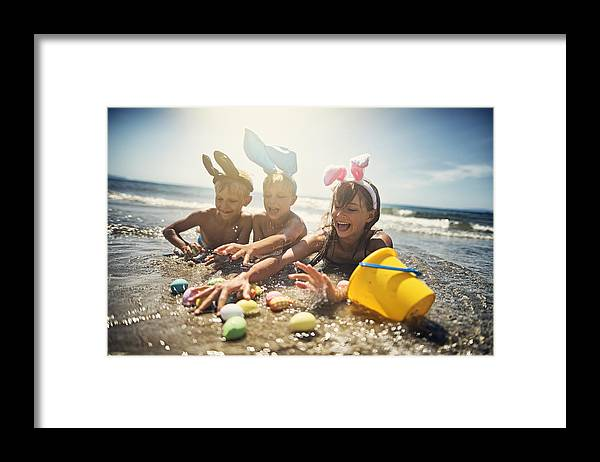 Easter Bunny Framed Print featuring the photograph Kids playing in sea during summer Easter by Imgorthand