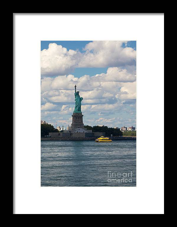 America Framed Print featuring the photograph Lady Liberty And Water Taxi by Jannis Werner