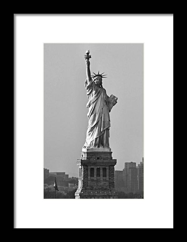 Statue Of Liberty Framed Print featuring the photograph Lady Liberty Black and White by Kristin Elmquist