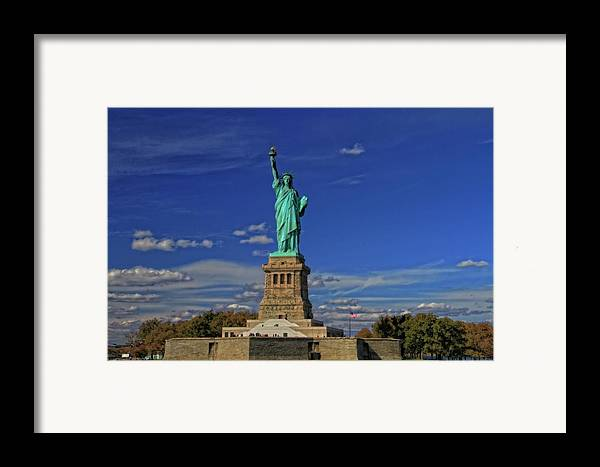 Lady Liberty In New York City Framed Print featuring the photograph Lady Liberty In New York City by Dan Sproul