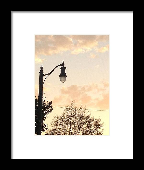Sunset Framed Print featuring the photograph Lamp Post And Cotton Candy Sunset by Allison Adams