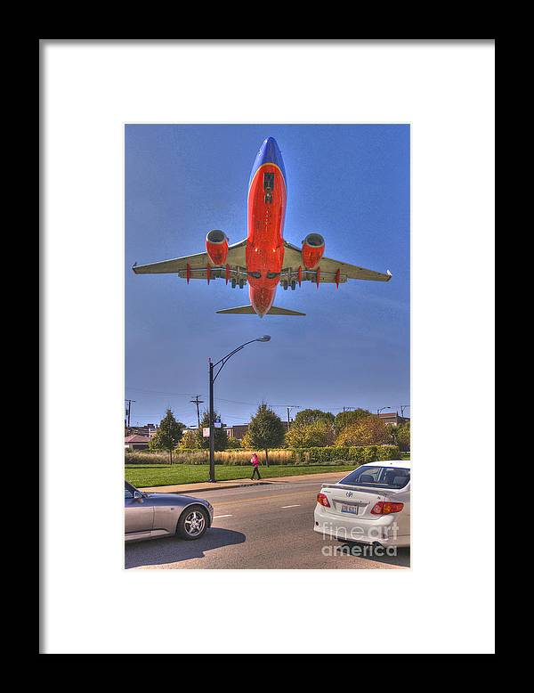 Plane Framed Print featuring the photograph Landing At Midway by Jim Wright