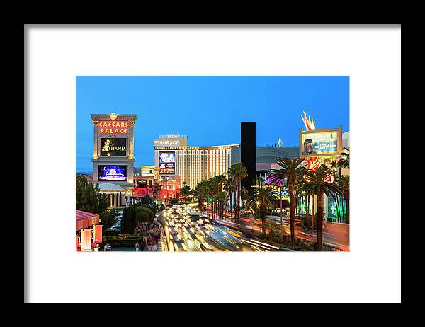 Built Structure Framed Print featuring the photograph Las Vegas Strip At Dusk With Hotels And by Sylvain Sonnet