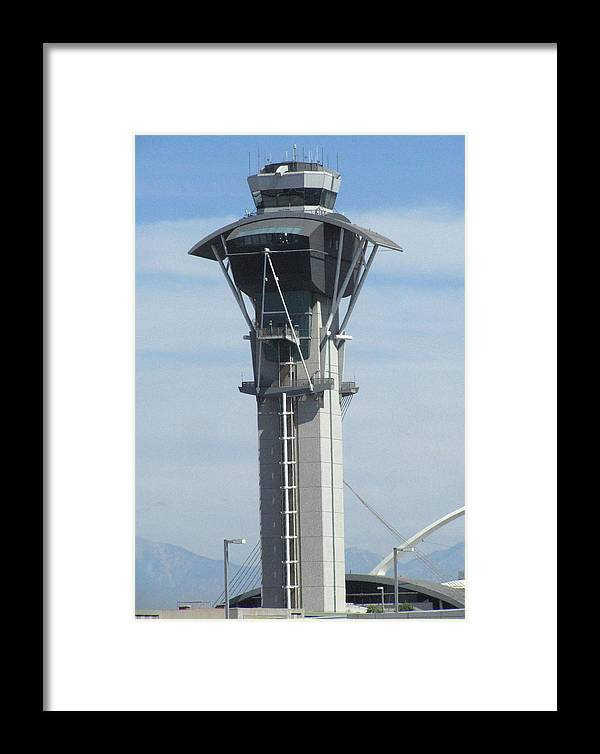 Lax Control Tower Framed Print featuring the photograph Lax Control Tower by Russell Einhorn