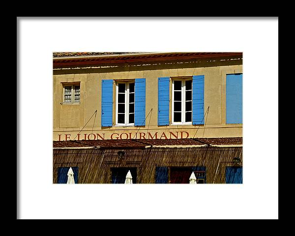 Le Lion Gourmand Framed Print featuring the photograph Le Lion Gourmand in Arles by Kirsten Giving