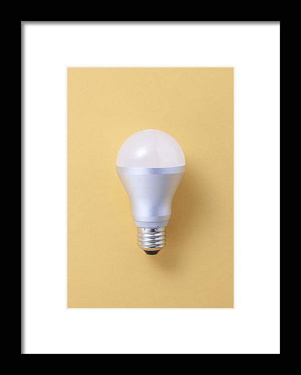 Environmental Conservation Framed Print featuring the photograph Led Bulb by Imagenavi
