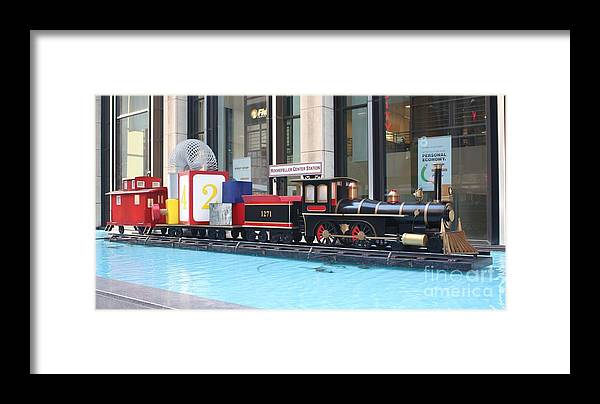 Life Size Toy Train Set In Nyc Framed Print featuring the photograph Life Size Toy Train Set In Nyc by John Telfer