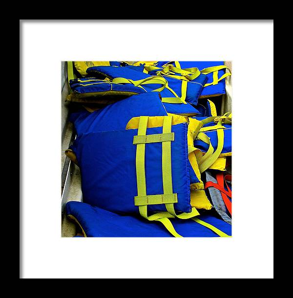 Lifejackets Framed Print featuring the photograph Lifejackets by Jeff Gater