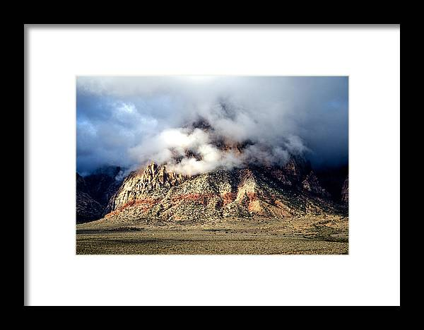 Mountains Framed Print featuring the photograph Light Storm by Darcy Grizzle
