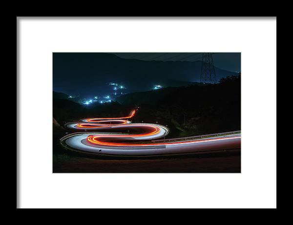 Zigzag Framed Print featuring the photograph Light Trails Of Cars On The Zigzag Way by Tokism