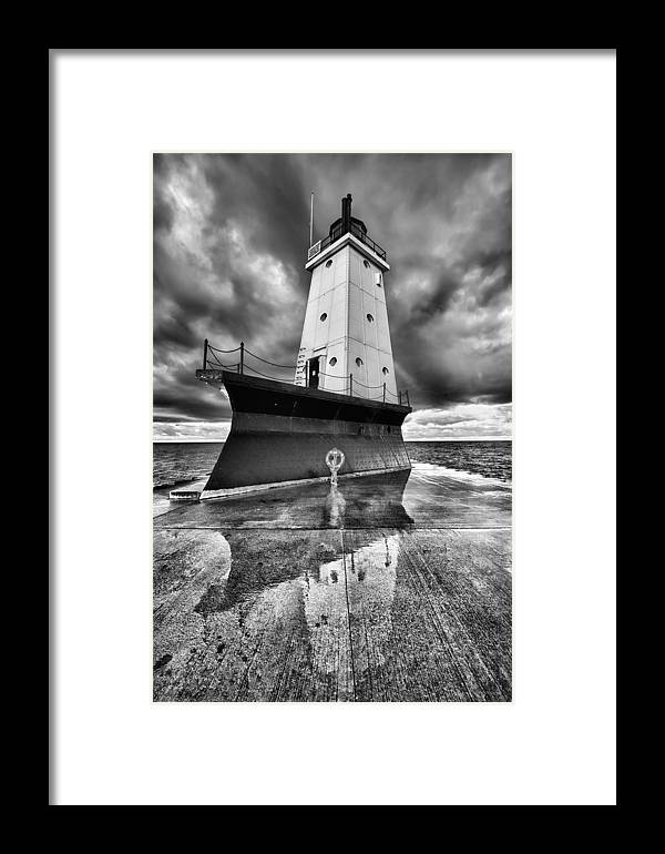 Clouds Framed Print featuring the photograph Lighthouse Reflection Black And White by Sebastian Musial