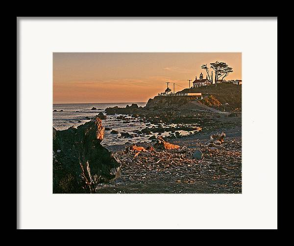 Lighthouse Sunset Framed Print featuring the photograph Lighthouse Sunset by Gracia Molloy