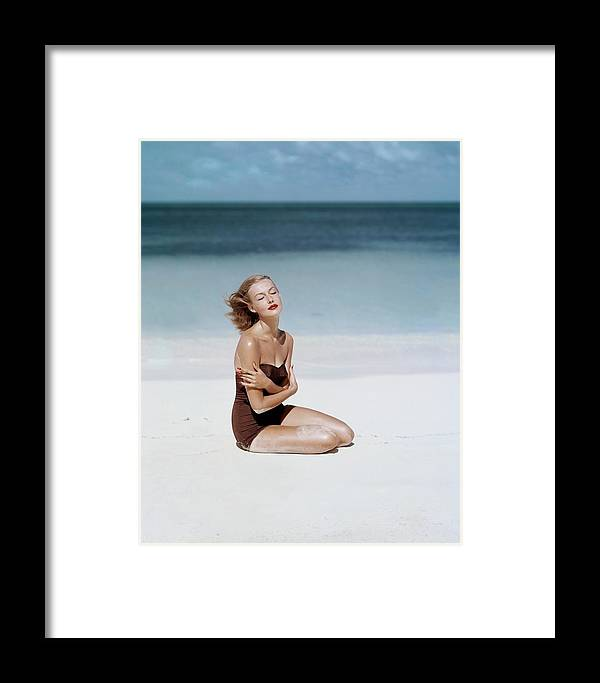 Fashion Framed Print featuring the photograph Liz Benn Sitting On A Beach by John Rawlings