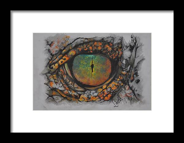 Lizard Eye Framed Print featuring the pastel Lizards Eye by Linda Ferreira