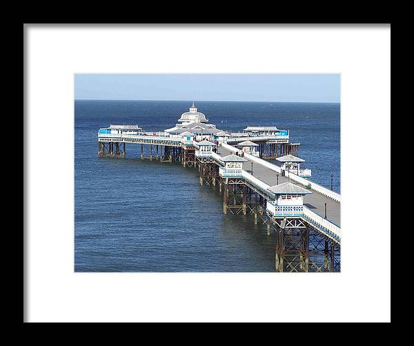 Piers Framed Print featuring the photograph Llandudno Pier by Christopher Rowlands