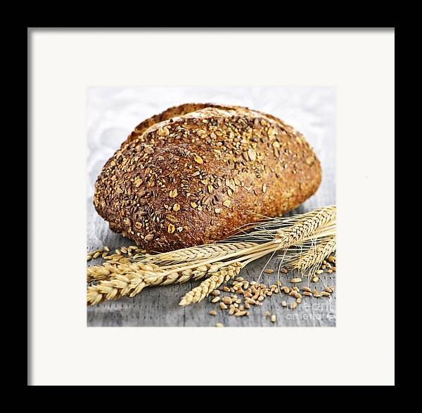 Bread Framed Print featuring the photograph Loaf Of Multigrain Bread by Elena Elisseeva
