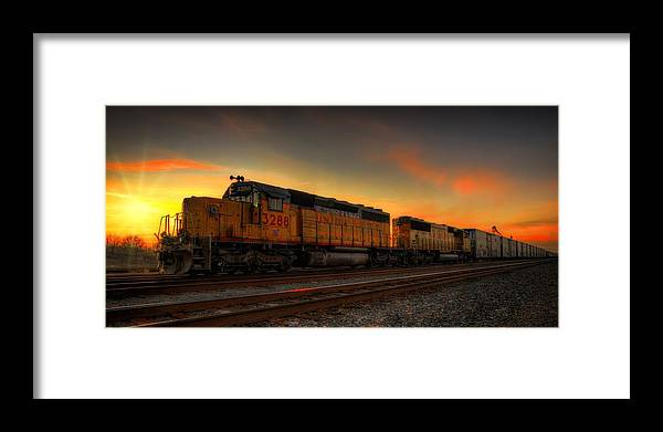 Train Framed Print featuring the photograph Locomotive Sunset by Kris Franklin