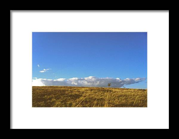Blue Sky Framed Print featuring the photograph Loneliness by Patrick Kessler