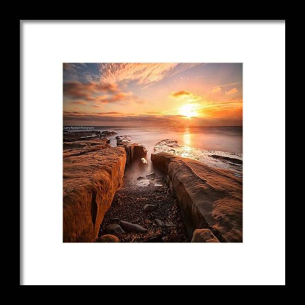 Framed Print featuring the photograph Long Exposure Sunset At A Rocky Reef In by Larry Marshall