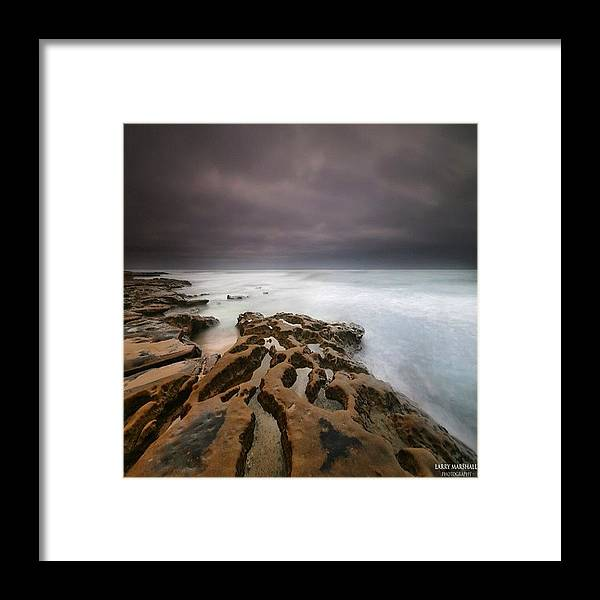 Framed Print featuring the photograph Long Exposure Sunset On A Dark Stormy by Larry Marshall