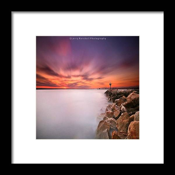 Framed Print featuring the photograph Long Exposure Sunset Shot At A Rock by Larry Marshall
