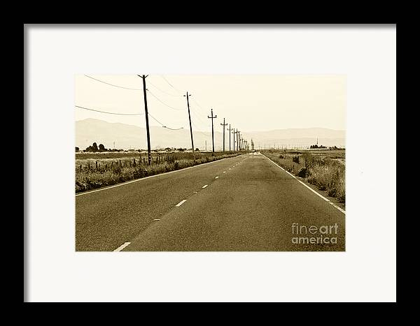 Road Picture Framed Print featuring the photograph Long Road Home by Artist and Photographer Laura Wrede