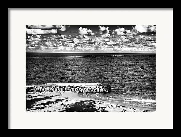 Looking Out Into The Ocean Framed Print featuring the photograph Looking Out Into The Ocean by John Rizzuto