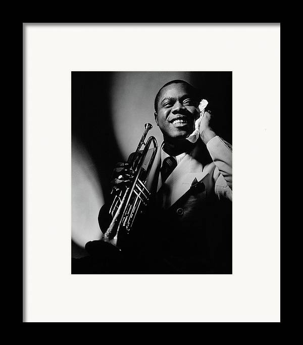 Portrait Framed Print featuring the photograph Louis Armstrong Holding A Trumpet by Anton Bruehl